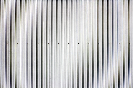 Wide shot of silver corrugated metal wall Фото со стока