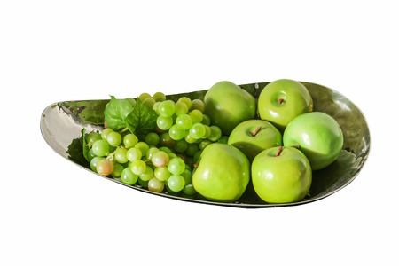decotated: Plastic green apples and grape on iron bowl ,isolate on white