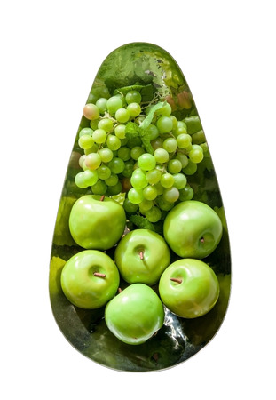 decotated: Plastic green apples and grape on iron bowl ,isolate