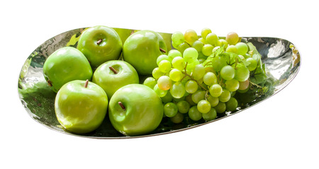 Plastic green apples and grape on iron bowl ,isolate white