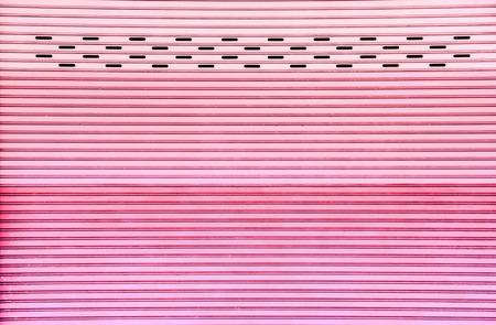 pink tone weathered grunge steel shutter door photo