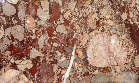 closeup: Red blood color stone texture