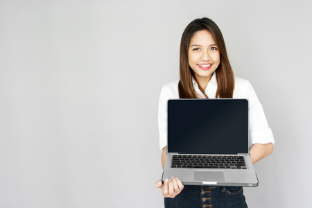 potrait: Potrait Asian lady show notebook computer in hand