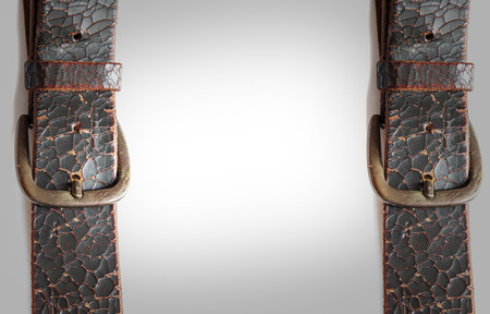 close uo: close uo old vintage leather belt on white background for text on center Stock Photo
