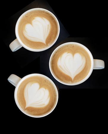 Cup of art cappuccino coffee heart symbol on top view photo