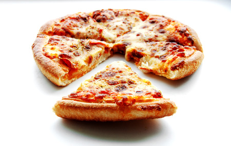 close up piece of peperoni pizza on white isolate
