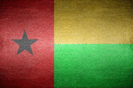 guinea bissau: closeup Screen Guinea Bissauflag concept on PVC leather for background Stock Photo