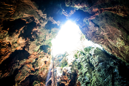 fantastic light in entrance of cave Koa-yoy at Thailand photo