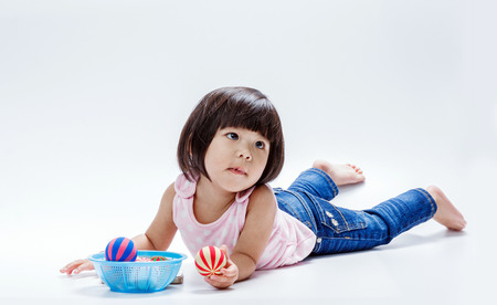 portrait short of asian girl playing color ball in isololate