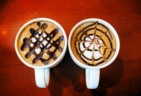 close up latte art jasmine line on ceramic mug on wood table photo