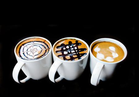close up latte art in ceramic mug on isolate photo