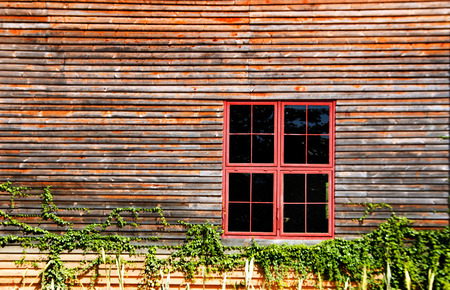 out door: red metal windows on wood wall out door shot