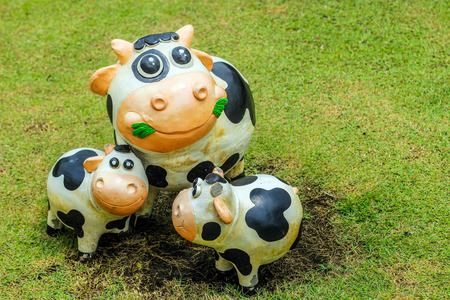 panama flag: close up smile cow statue with cement decoration outdoor Stock Photo