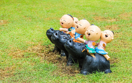 thailand culture: smile children ride buffalo with bake cray decoration outdoor park show Thailand culture Stock Photo