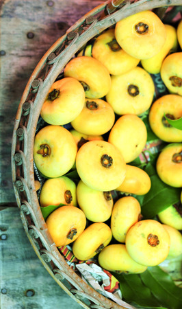 diospyros: close up Diospyros decandra Lour. Thai fruit in basket Stock Photo