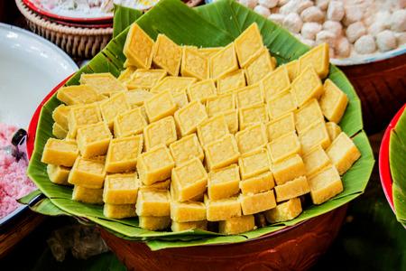 trapezoid: close up crush peanut Thai dessert on banana leaf in trapezoid