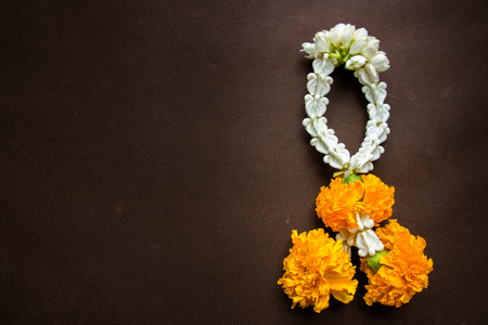 malai: close up group of Jasmine and Yellow Marigold Garland flower for Pay homage to the Buddha Stock Photo