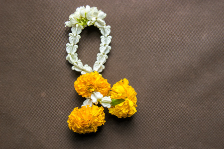 homage: close up group of Jasmine and Yellow Marigold Garland flower for Pay homage to the Buddha Stock Photo