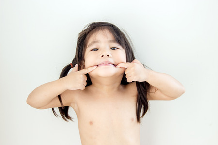 chinesse: cute node asian girl playing mouth funny action on white background Stock Photo