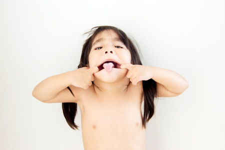node: cute node asian girl playing mouth funny action on white background Stock Photo