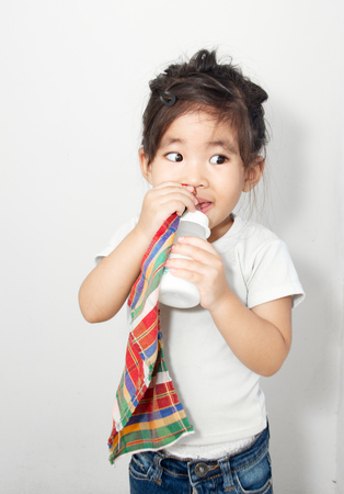 chinesse: asian girl addict her textile and milk bottle