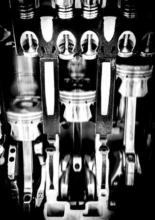 aluminum rod: close up automobile engine moving in dark shot