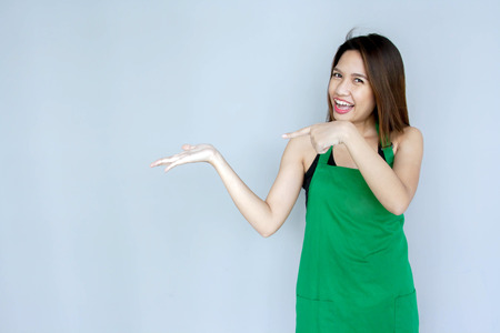 girl action: asian girl action with green apron suite on clear background Stock Photo