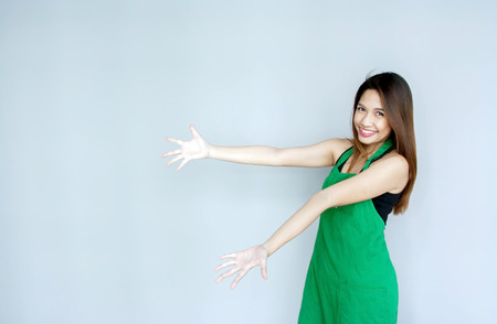 girl action: asian girl action with green apron suite on clear background and copy space