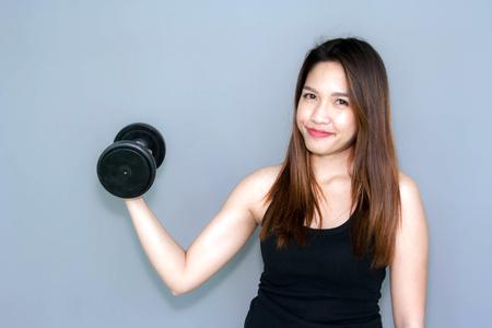 dumbell: Thai lady hold dumbell for exercise