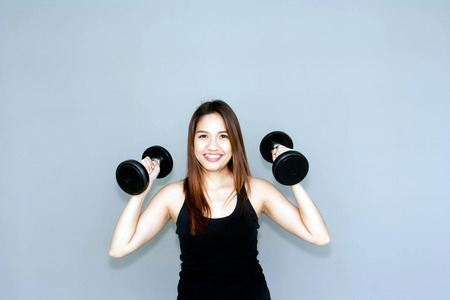 dumbell: Thai lady hold dumbell for exercise on clear background