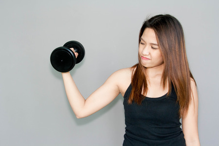 Thai lady hold dumbell for exercise on clear background