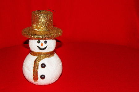 snow man with gold hat decoration on white background