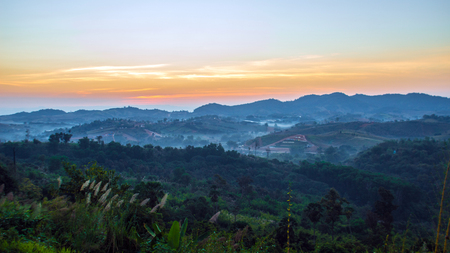 faintly visible: sunrise on the mountain natural  landscape Stock Photo
