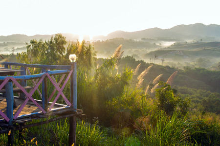 faintly visible: sunrise on the mountain with wood bacony on view point Stock Photo