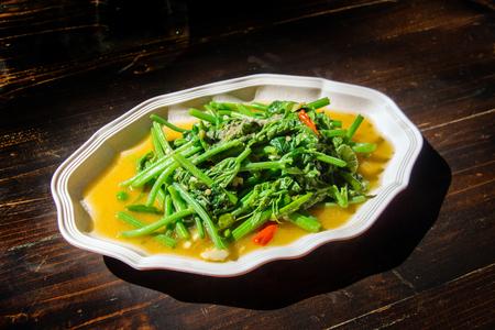 chayote: chayote vegetable fried Thai food on dark wood table