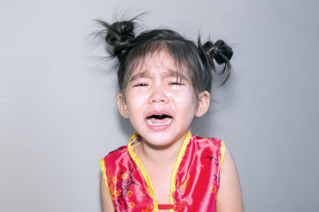 crying girl in Chinese suite on clear background
