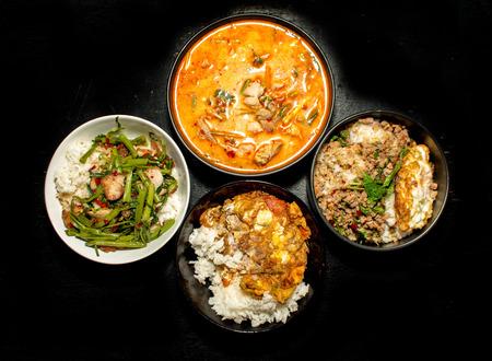 favorite soup: four favorite Thai food menu Krapoa,Tom-yum,soup,omelette on dark background