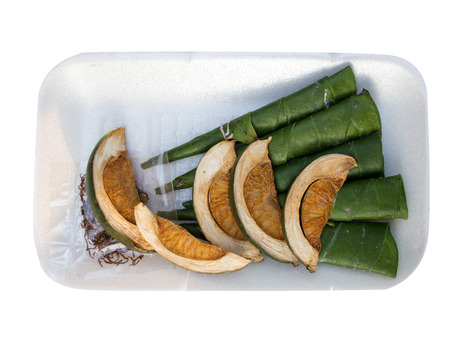 Areca betel nut chewed with the leaf on white plate isolate for praying in asian religion