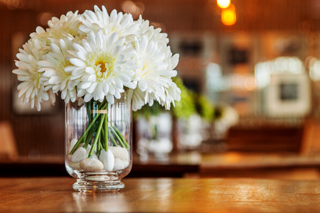 restuarant: close up white daisy in glass vase for decoration table at restuarant