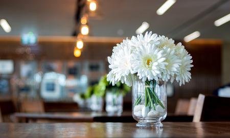 ronantic: white daisy in glass vase for decoration table at restuarant
