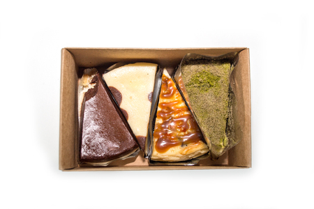 chees: mix cake in the paper box on white background