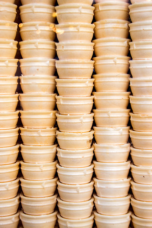 icecream cone: close up wafer icecream cone arranging in roll for background Stock Photo