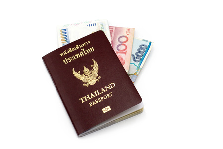 holidays vacancy: Thailand passport book and bank note on white isolate