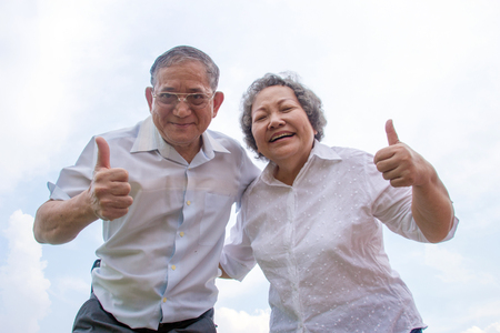 aging woman: couple asian grandmother and grandmather smile and show happy life