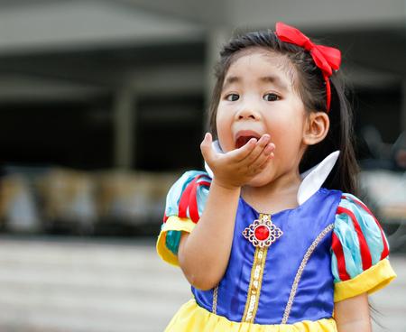 fashion story: potrait princess dress with cute asian girl eat apple
