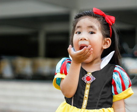 princess dress: potrait princess dress with cute asian girl eat apple