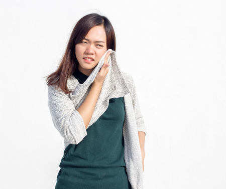 hot temperature: asian Thai lady teen wearing swetter get hot temperature action on white background