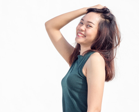 turn back: sexy thai asian lady face show long hair turn back funny action on white Stock Photo