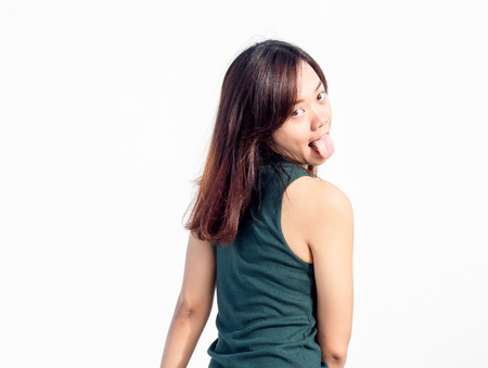 turn back: sexy thai asian lady show long hair turn back funny action with trunk on white