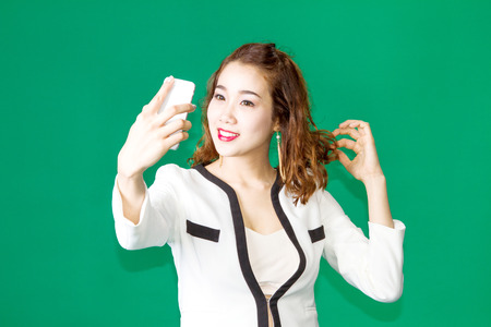 vdo: asian thai girl use front camera of mobile phone for conference vdo call Stock Photo